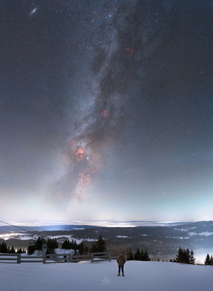 Winter galaxies over the moonlit Jura by Adrien Mauduit