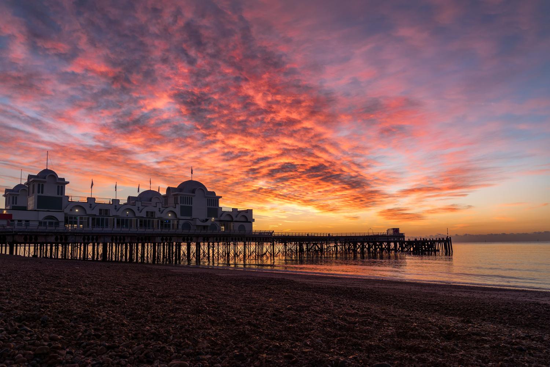 Colourful sunrise in Portsmouth. by panya sinsuebphol