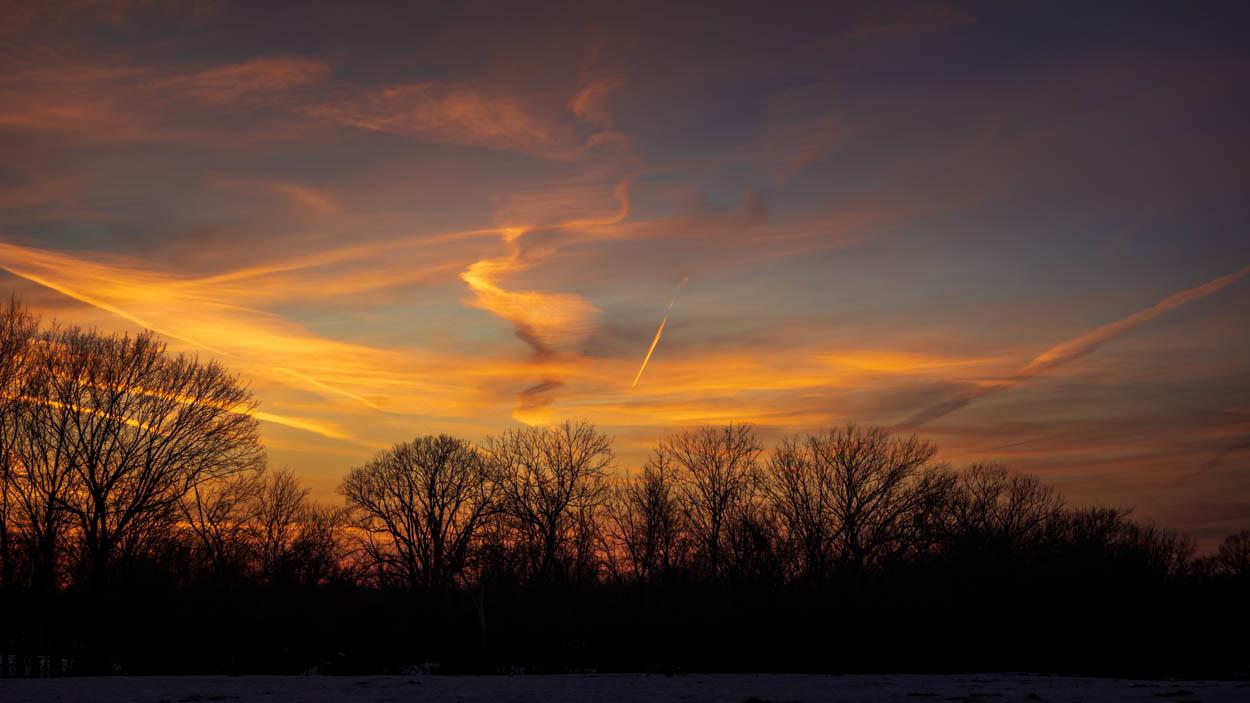 Sunset Contrails by Duane Dinham