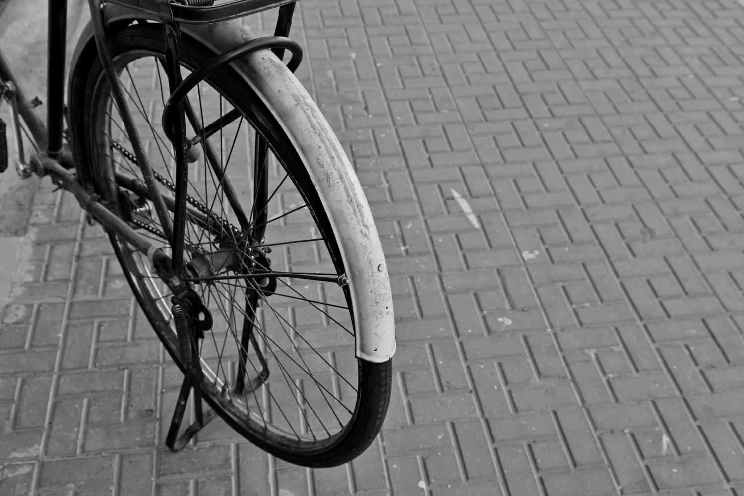 Old retro styled Bicycle in the street by Savvas Stavrinos