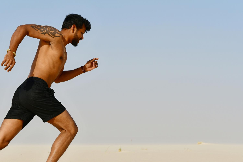 Running young man  by Savvas Stavrinos