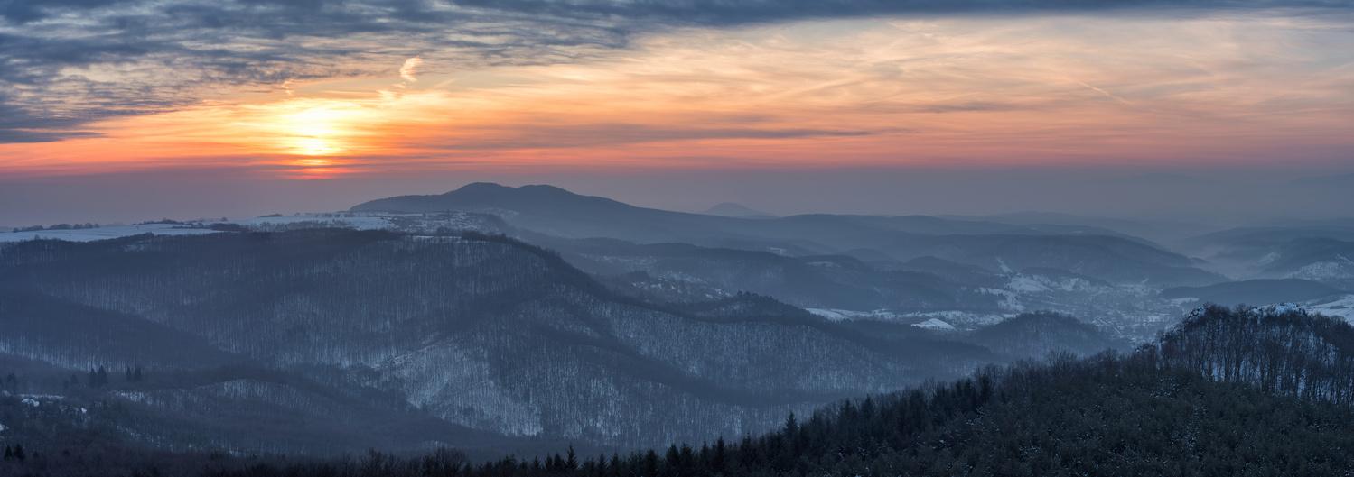 Sunrise behind hills by Gabor Szarvas