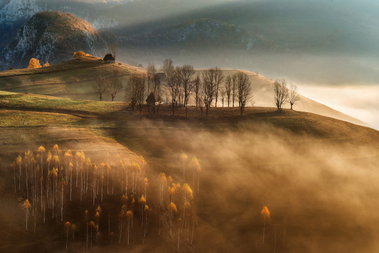 Sunrise over the hills by Alex Robciuc