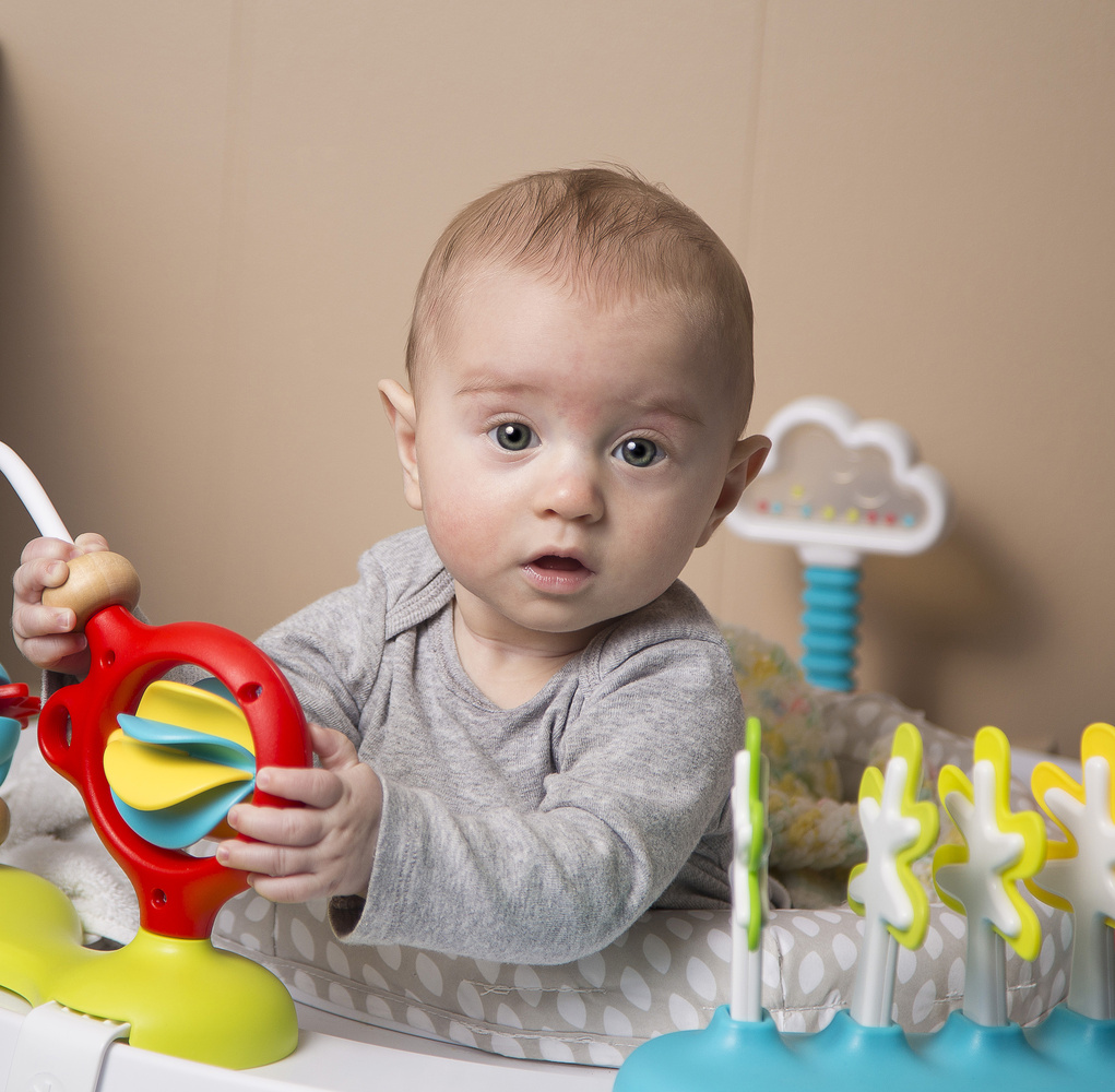 Boy playing with jumper toy by Josh Butts