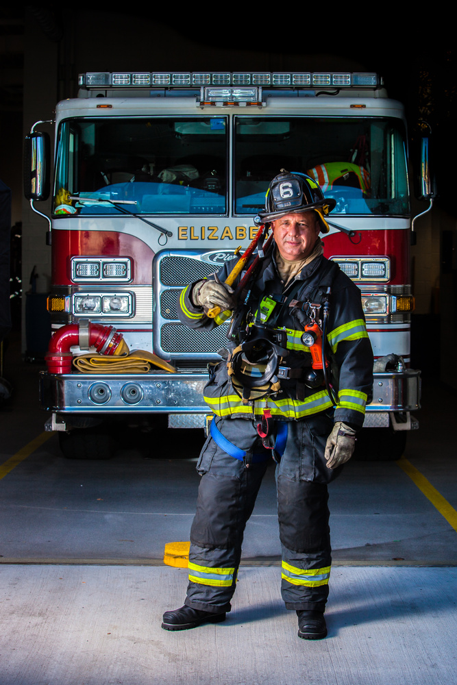Fire Fighter with his Rig by nicolas baptista