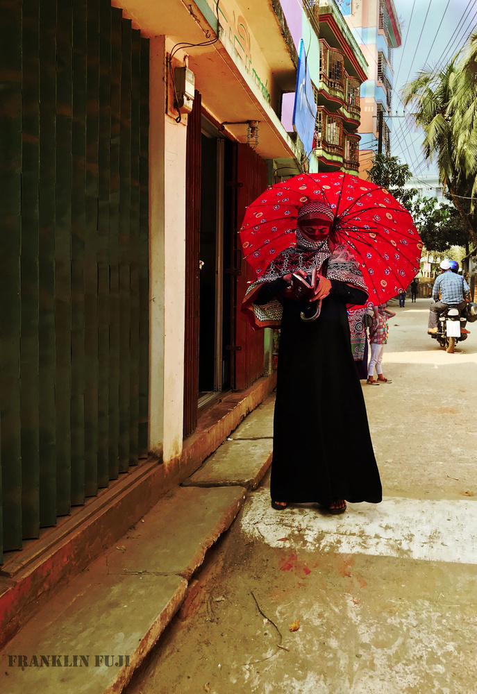 The lady with red umbrella by Franklin Biswas