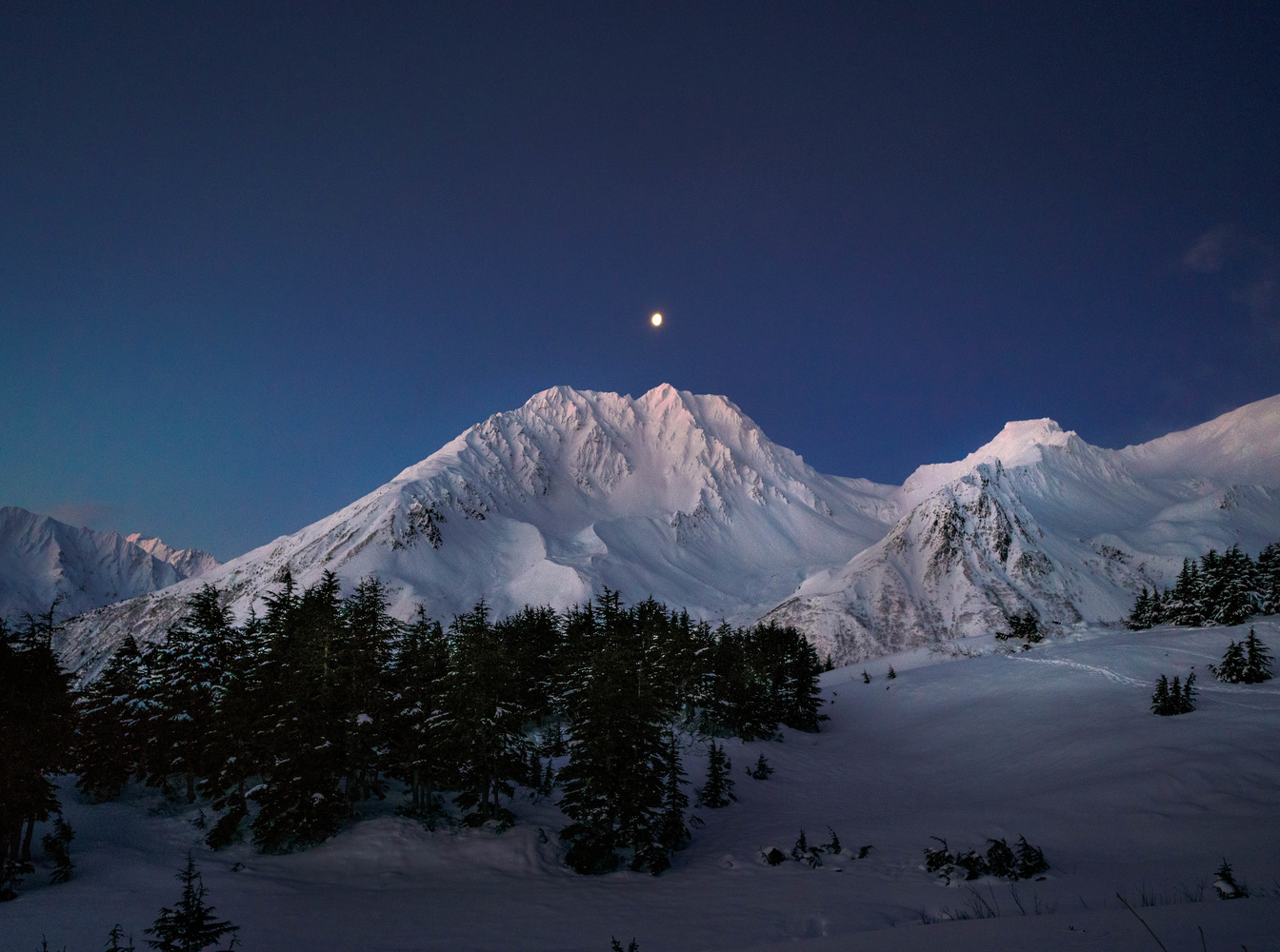 The Moon Over Resurrection Peaks by TYLER YATES