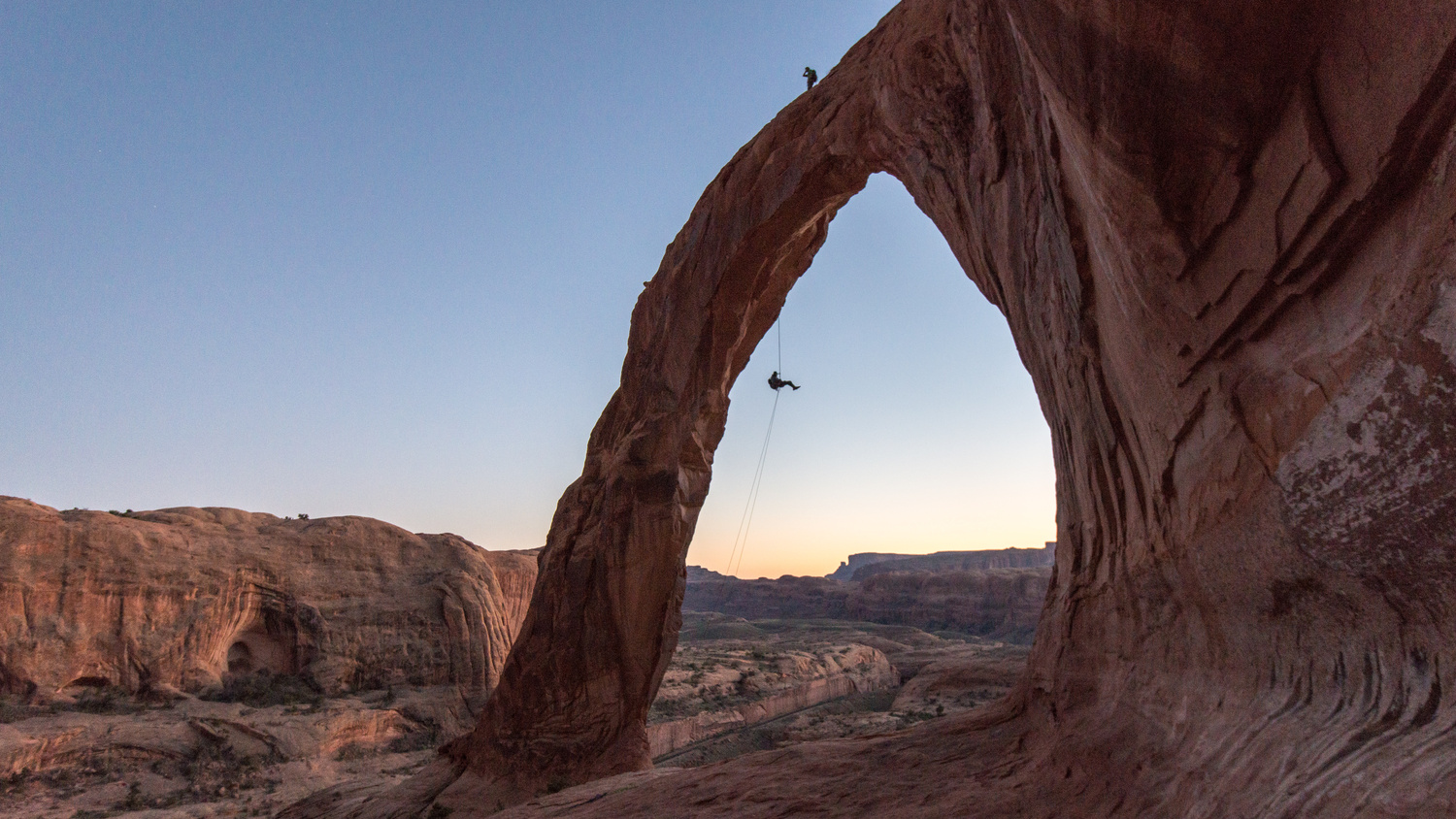 Rappelling from Corona Arch by TYLER YATES