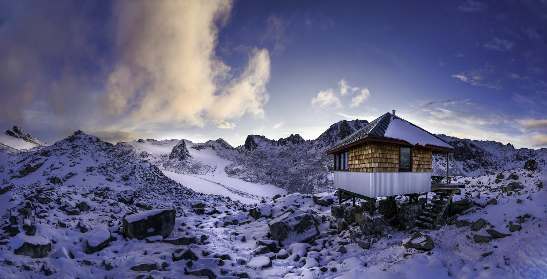 Snowbird Hut Dusk Pano by TYLER YATES