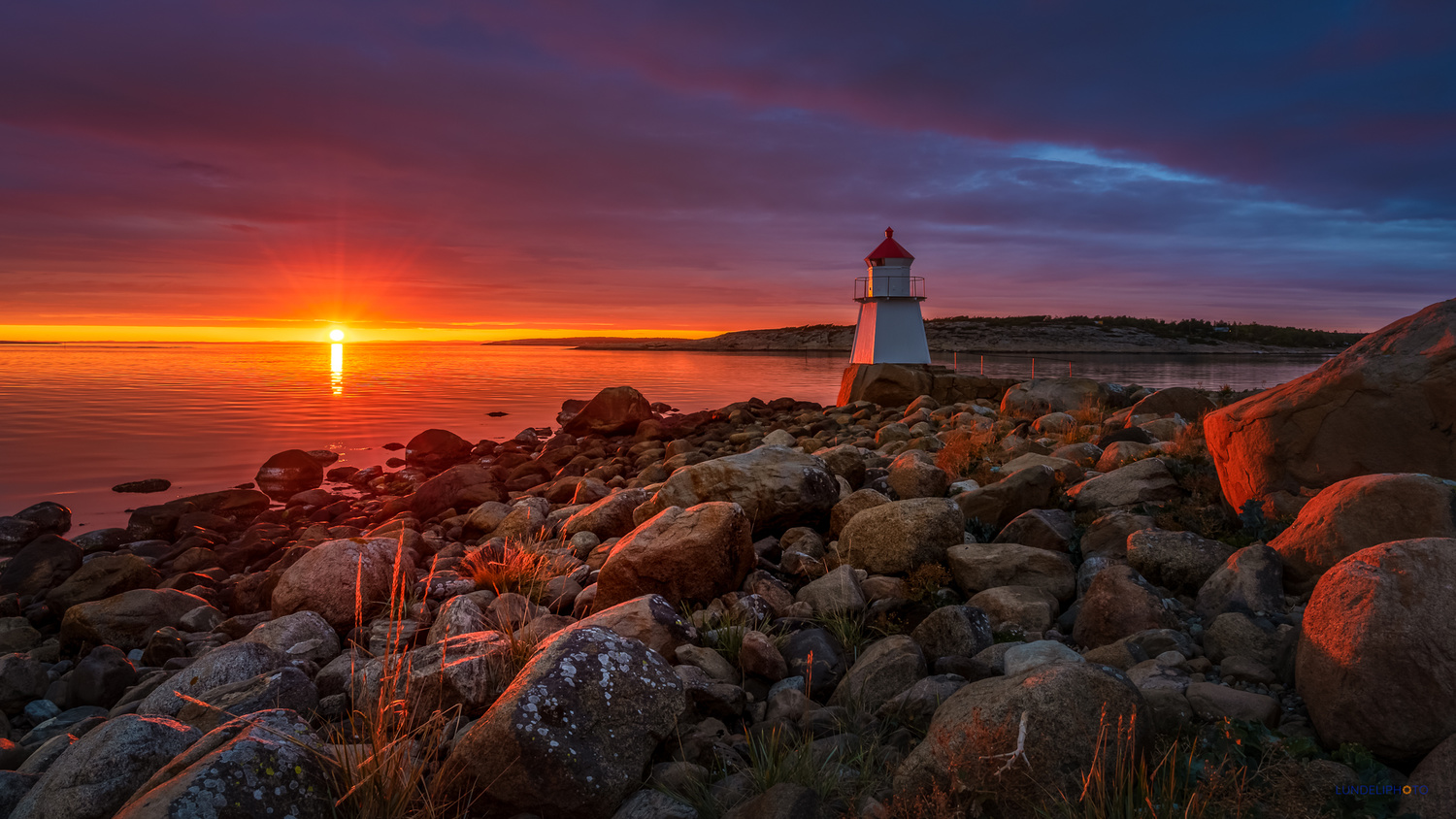 The lighthouse by the waters edge by Hans Jørgen Lindeløff