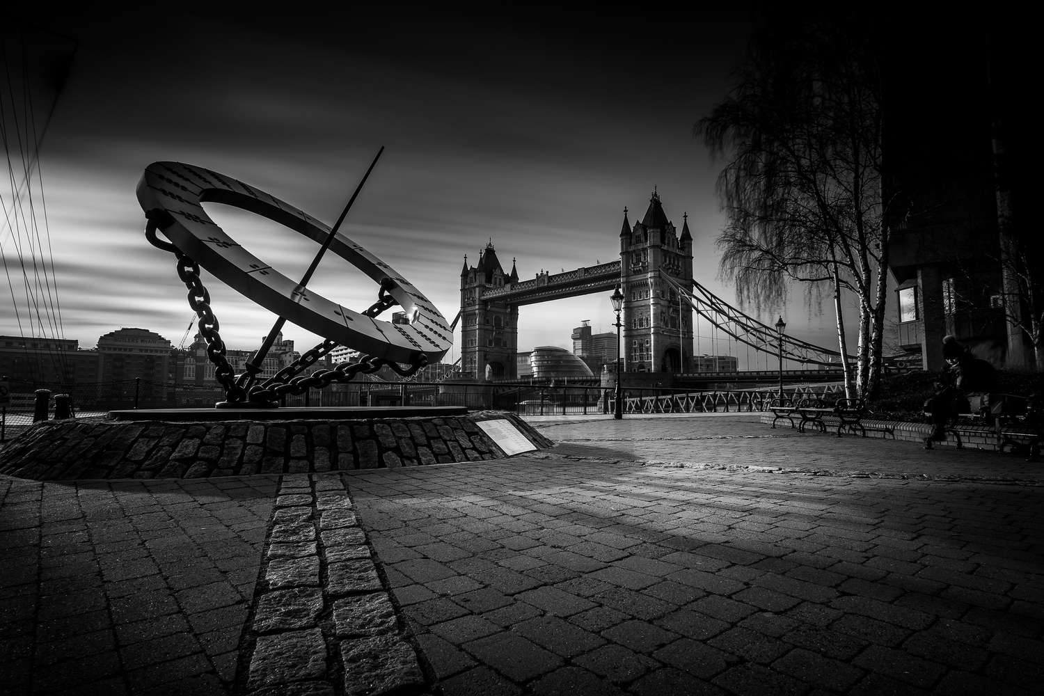 The sun clock and the tower bridge by Laurent J.A. Belener