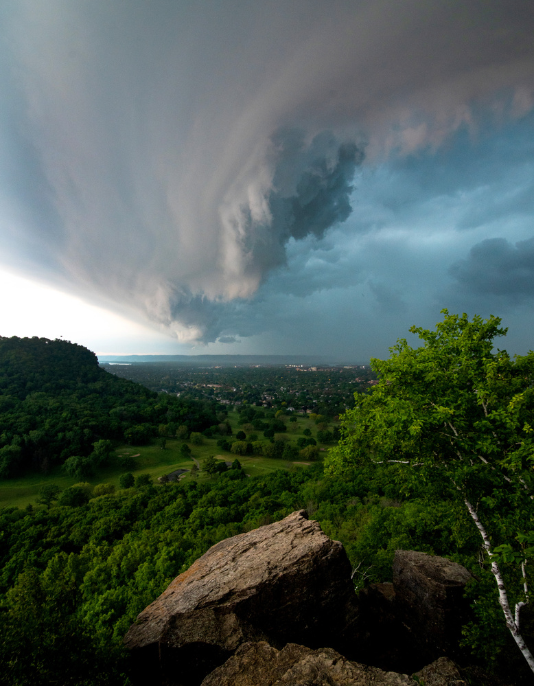 Storm Clouds over a Town by jason stuempges