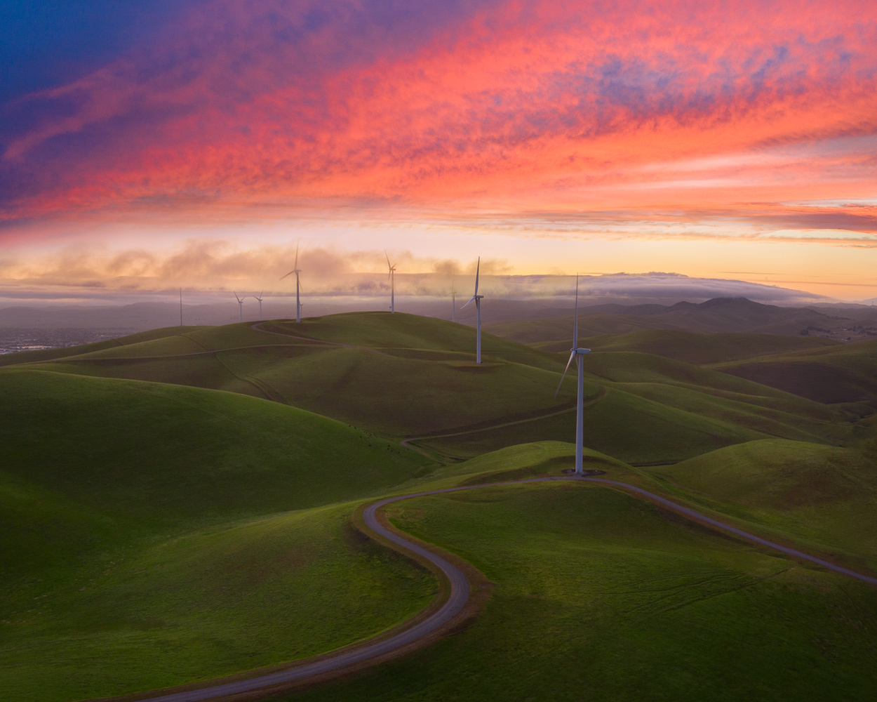Windmills with fiery sky by Ryan Fitzsimons