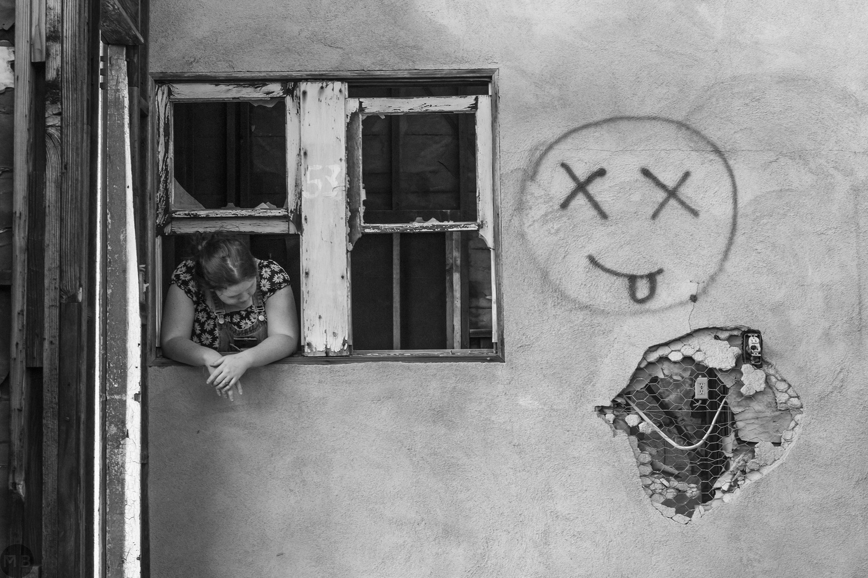 Girl in window by Markus Baumbach