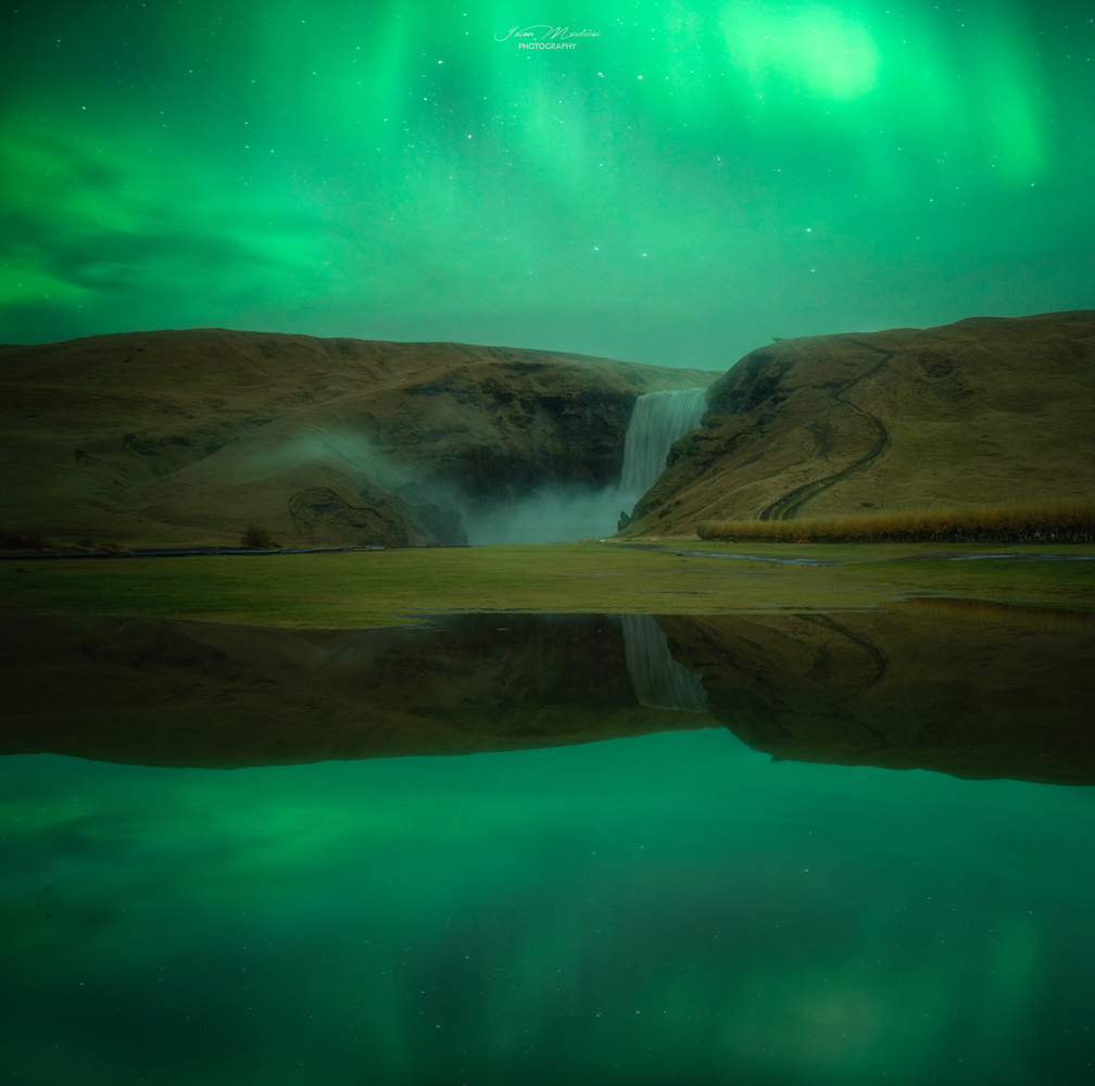 Lady Green at Skogafoss by Jason Mordecai