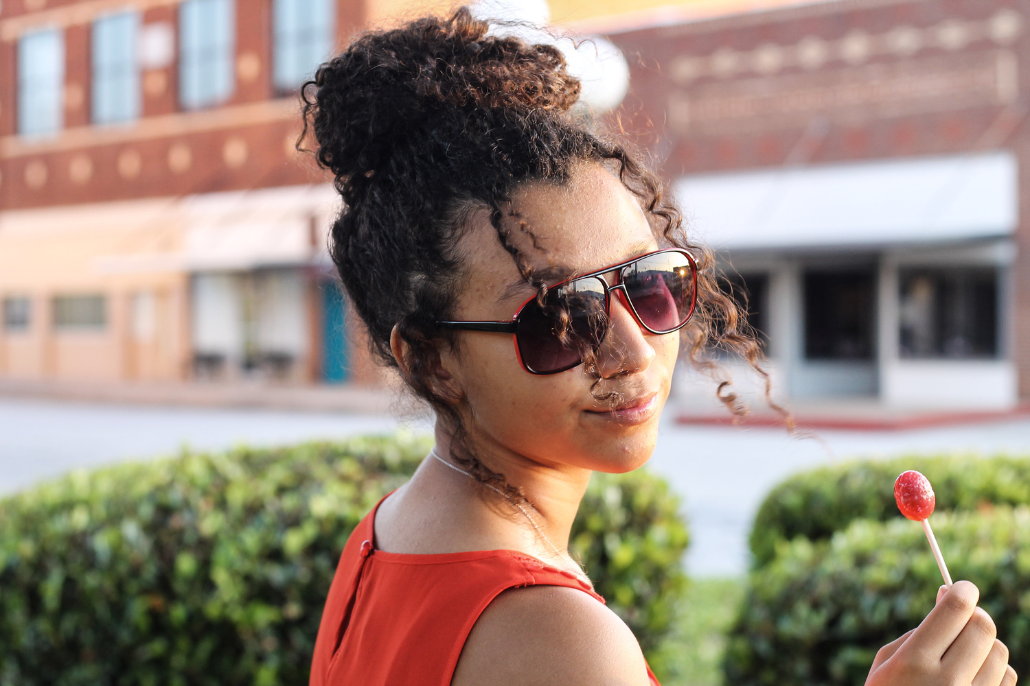 Girl In The Red Sunglasses by Myron Edwards