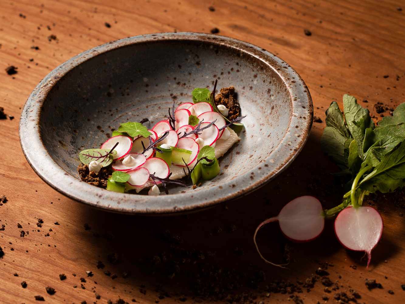 trout with radishes by Till Luz