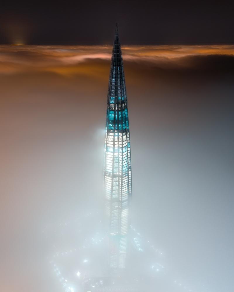 Skyscraper in a fog by Mikhail Proskalov