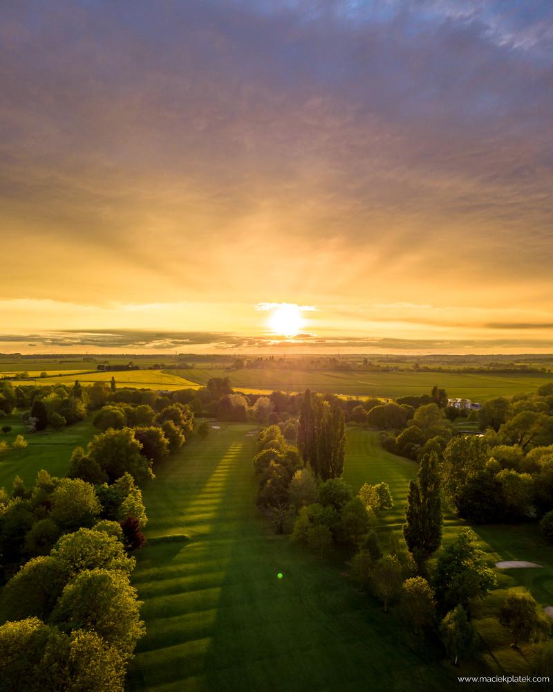Sunset at the golf club by Maciek Platek