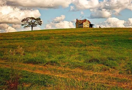 Farmhouse on hill by Eliott James