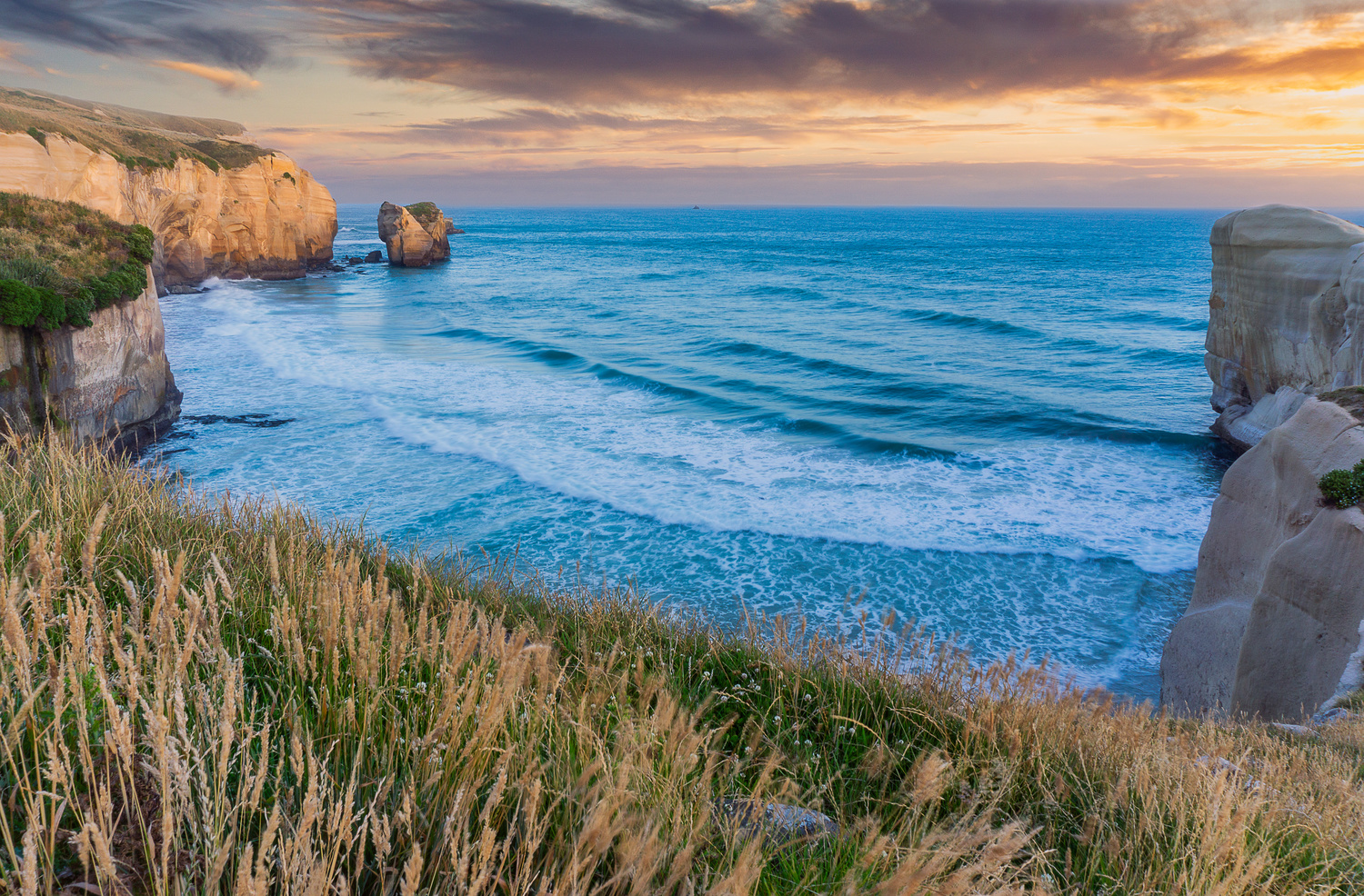 Sunset at Tunnel Beach by Jesse Vance