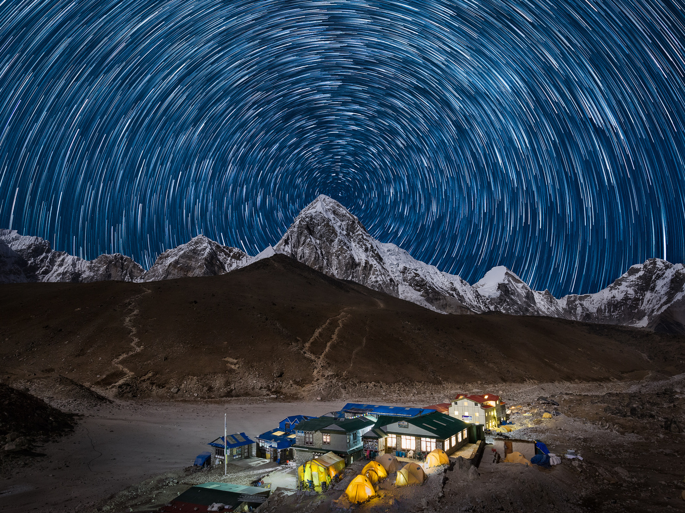 Star trail in front of Kalapathar and Pumori moutain by Thomas Andlauer