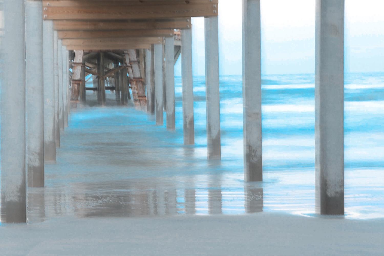 Beach pier by Dustin Sutton