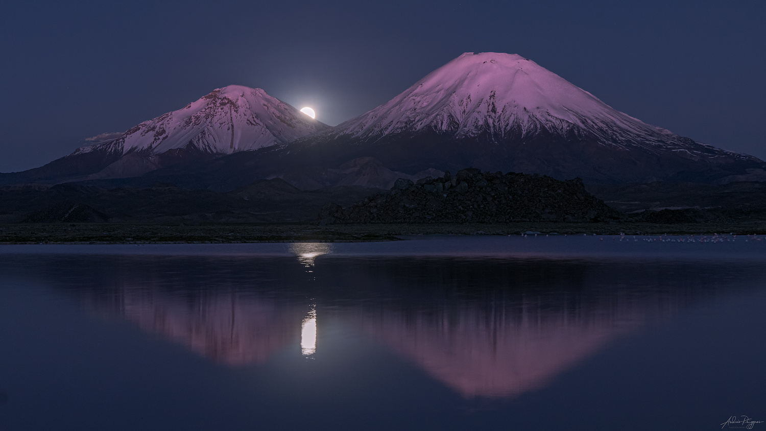 Moonrise between Payachata volcanos by Andres Puiggros