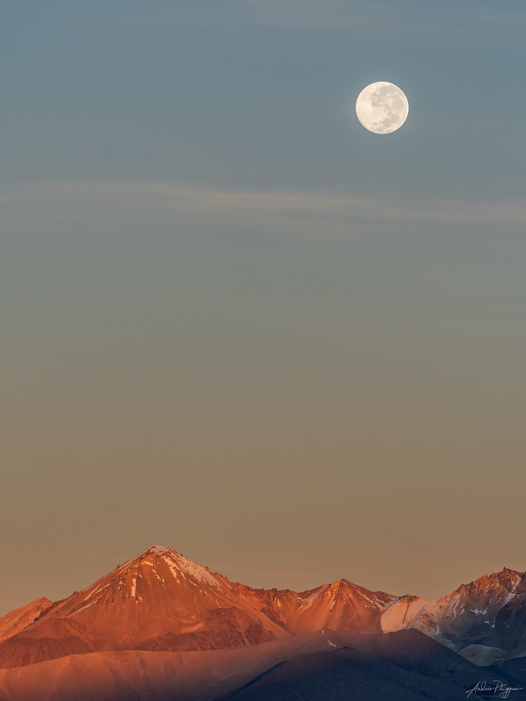 Moon setting in Volcan Taapaca by Andres Puiggros