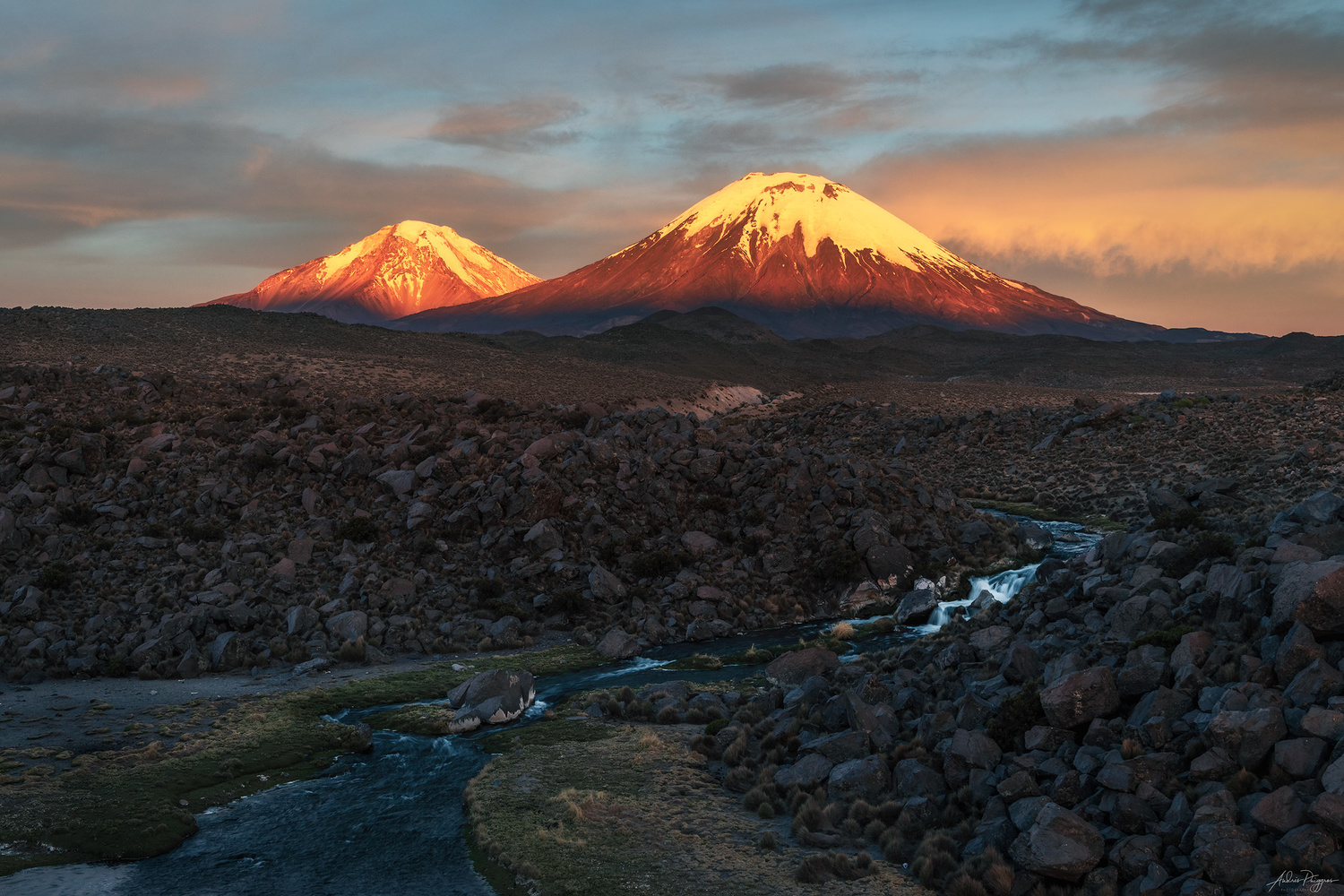 Payachatas volcanoes at sunset by Andres Puiggros