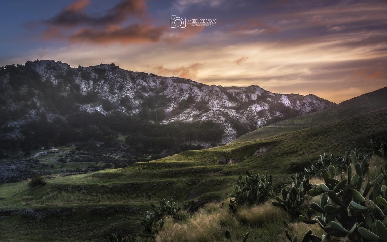 The sunset over the hills by Neide Paixão