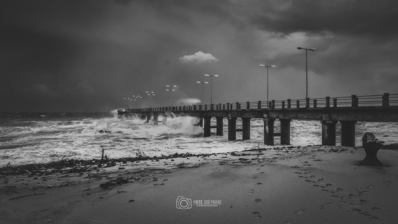 Bad weather on the pier by Neide Paixão