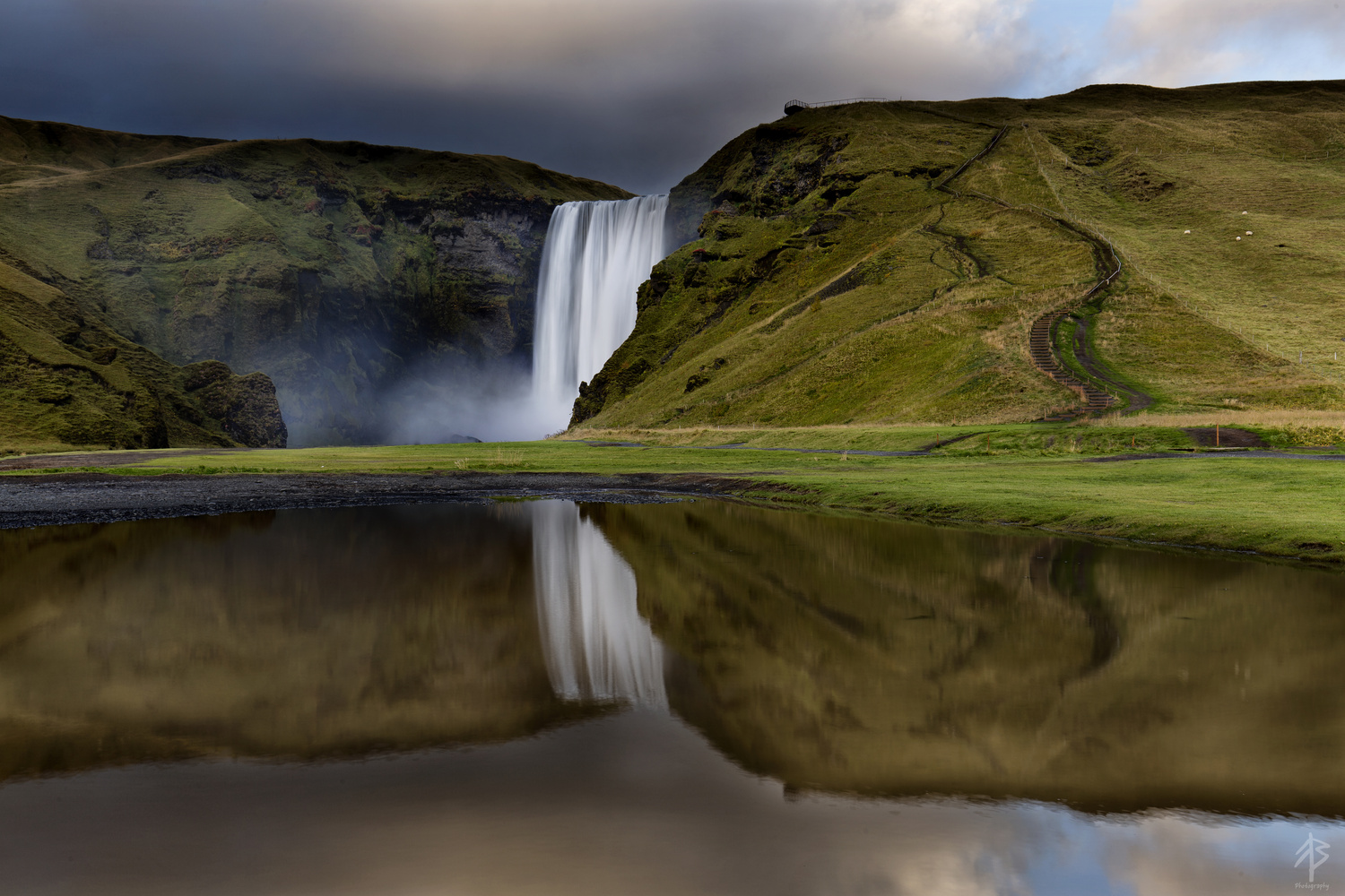 Skogafoss Reflections by Fearghal Breathnach