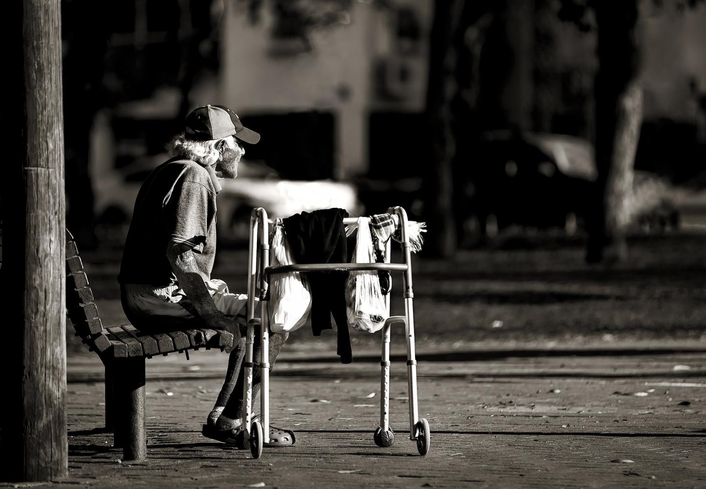 Sitting on a bench. by Nir Roitman