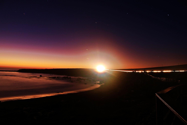 Headlights at dawn by Kenneth Hofmann