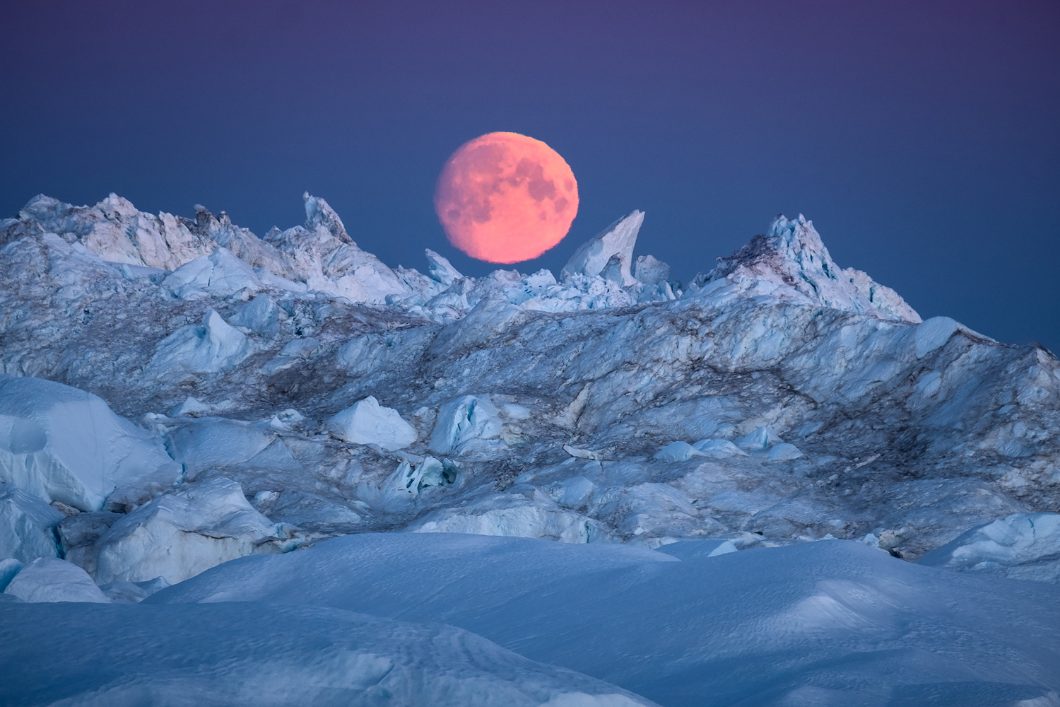 Moon rising over Icebergs in Ilulissat Icefjord by Maria Sahai