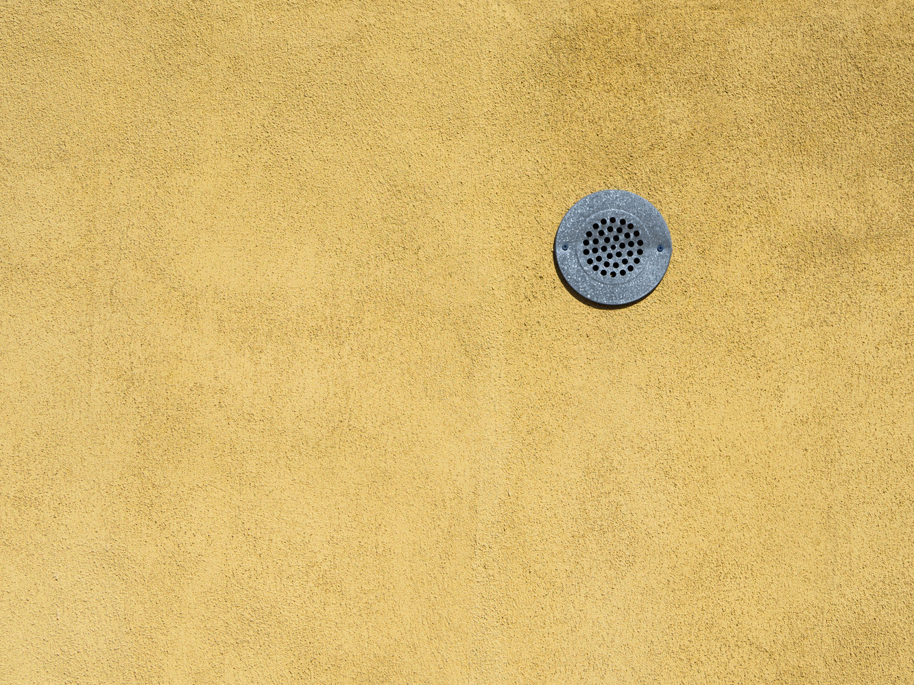Lonely drain on the wall by Ryan Giglio