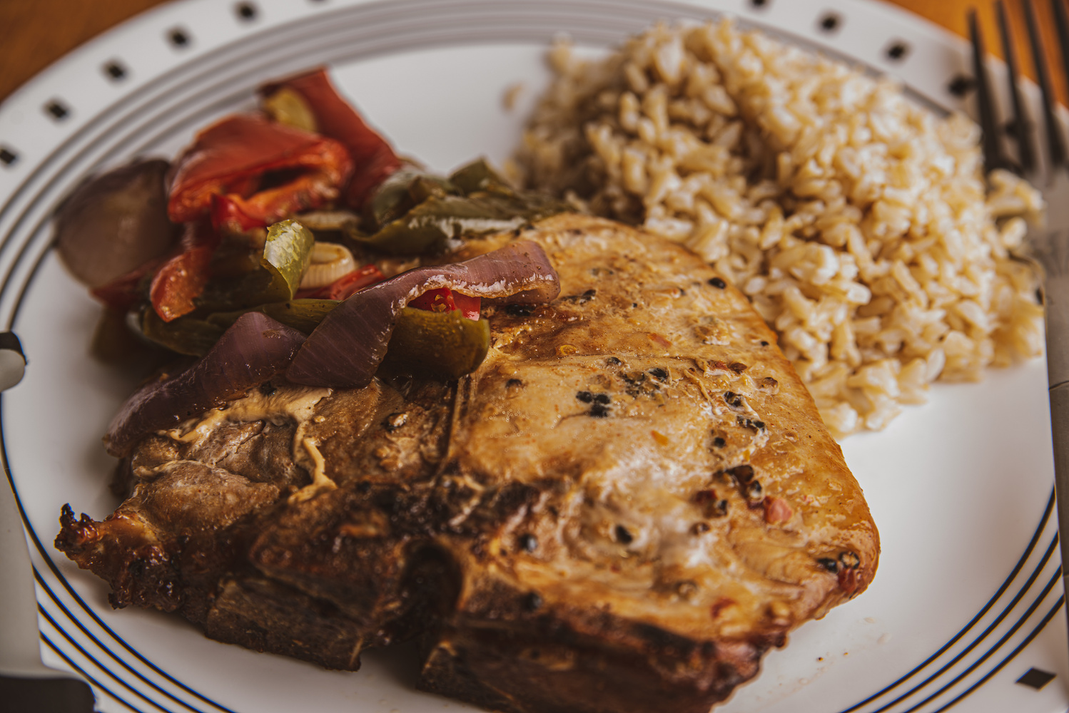 Pork Chop with Brown Rice, and Peppers & Onions by Gary Brosius