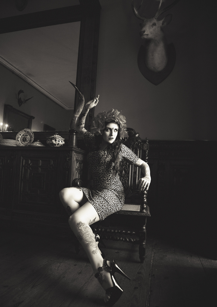 goth sitting in hall by Lilly Rose