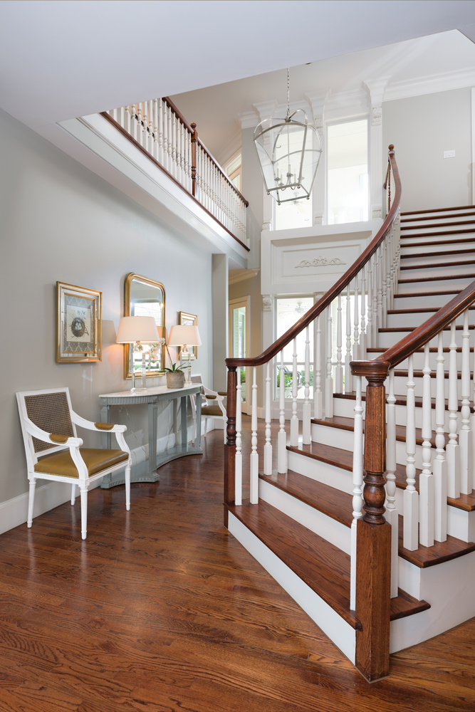 Entry with grand staircase by Reagan Jobe