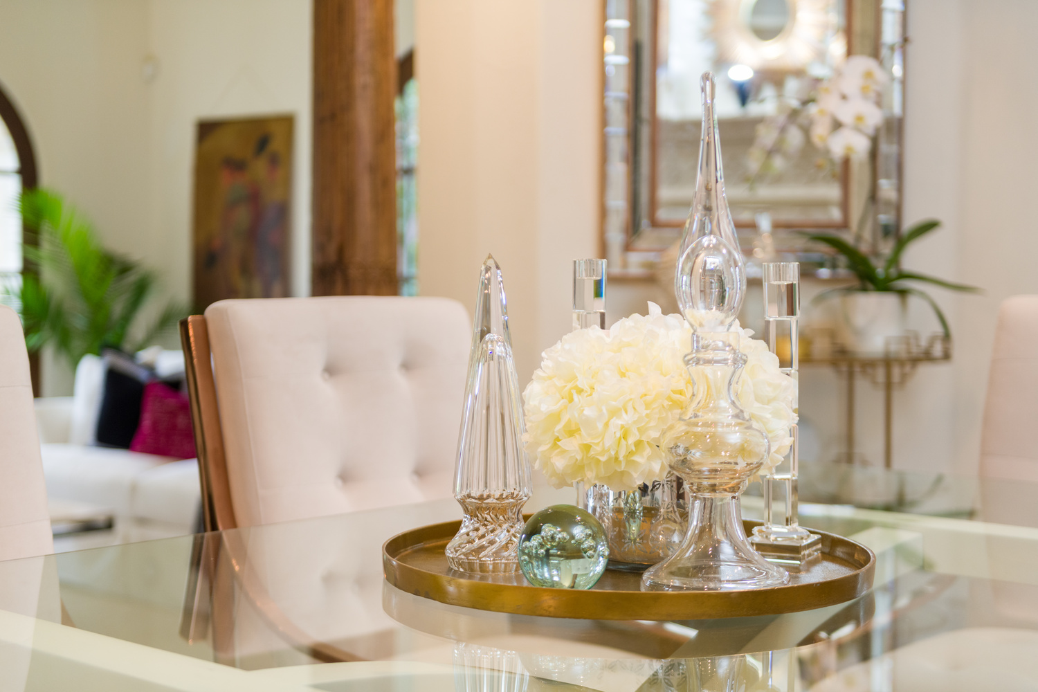 Flowers on a dinning room table by Reagan Jobe