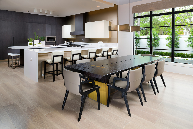 Modern dinning next to minimalist kitchen by Reagan Jobe