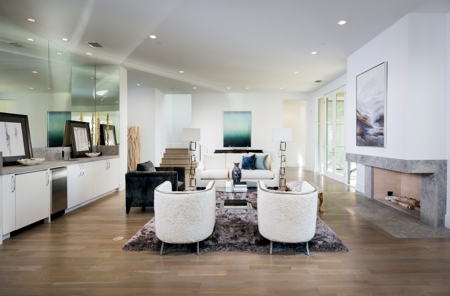 Stunning living room with reflecting sunlight by Reagan Jobe