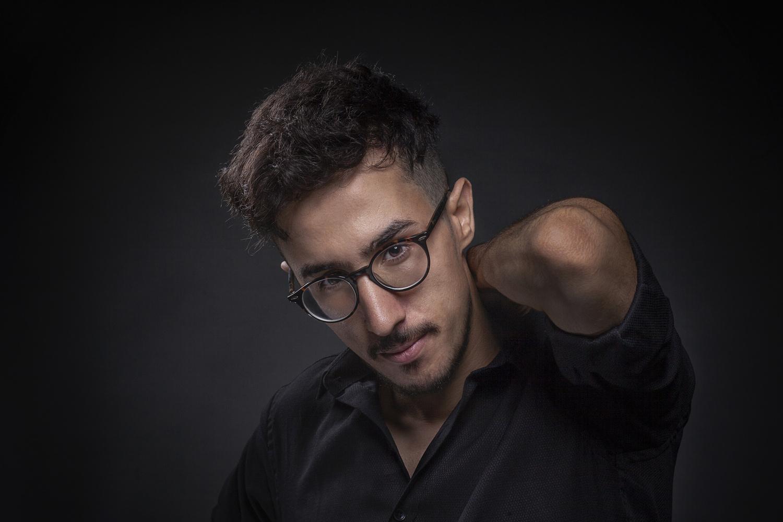 Low-Key Male Portrait by Firat Tuzunkan