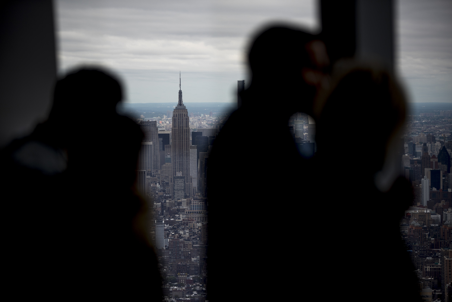 Empire State behind the crowd by Dave Levins