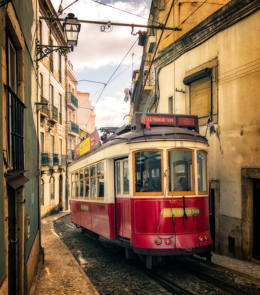Tram in Alfama | Lisbon, Portugal by Nico Trinkhaus