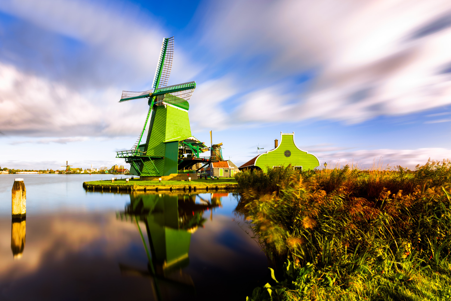 Windmills in Zaanse Schans | Netherlands by Nico Trinkhaus