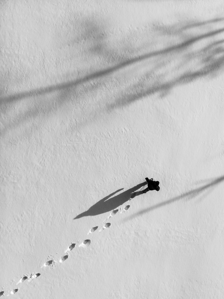 Walking man walks by Adam McKay