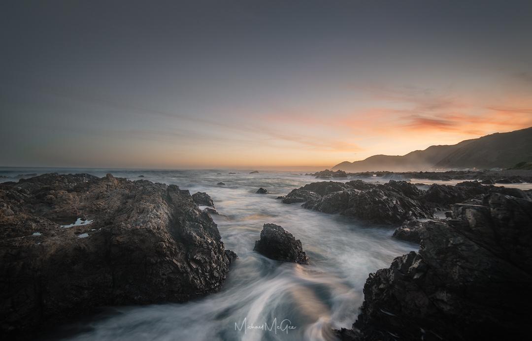 Last light at Taputeranga by Michael McGee