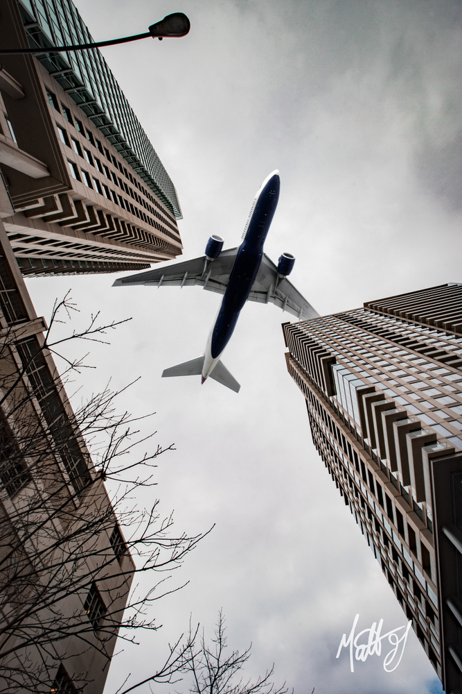 Plane over City by Matt Goudreau